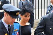 (L-R) Prince William, Duke of Cambridge and Meghan, Duchess of Sussex attend as members of the Royal Family attend events to mark the centenary of the RAF on July 10, 2018 in London, England.