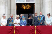 (L-R)  Sophie, Countess of Wessex, Prince Charles, Prince of Wales, Camilla, Duchess of Cornwall, Prince Andrew, Duke of York, Queen Elizabeth II, Meghan, Duchess of Sussex, Prince Harry, Duke of Sussex, Prince William, Duke of Cambridge and Catherine, Duchess of Cambridge watch the RAF flypast on the balcony of Buckingham Palace, as members of the Royal Family attend events to mark the centenary of the RAF on July 10, 2018 in London, England.