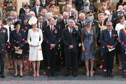 Prime Minister Theresa May (second left), the Duke and Duchess of Cambridge King Philippe (fourth right) and Queen Mathilde (third right) watch as the poppies fall from the roof of the Menin Gate on July 30th, 2017 in Ypres, Belgium.