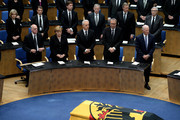 (L-R) President of the Bundestag Norbert Lammert, Chancelor Angela Merkel, Regional chairman of the Saxony CDU Stanislaw Tillich, President of the Constitutional Court Andreas Vosskuhle and former Foreign Minister of the United States of America James Baker attend the state memorial ceremony to honor Hans-Dietrich Genscher at World Congress Center on April 17, 2016 in Bonn, Germany. Genscher, a member of the German Free Democrats (FDP), served as German foreign minister from 1974 to 1992 and was widely respected as a shrewd and successful diplomat through the end of the Cold War era.