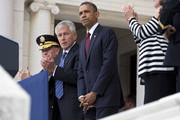 U.S. President Barack Obama, flanked by U.S. Secretary of Defense Chuck Hagel and General Martin E. Dempsey, chairman of the joint chiefs of staff, stands after speaking at a ceremony on Memorial Day at the Tomb of the Unknowns at Arlington National Cemetery on May 27, 2013 in Arlington, Virginia. For Memorial Day President Obama is paying tribute to military veterans past and present who have served and sacrificed their lives for their country.
