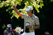Ryo Ishikawa of Japan checks the wind on the 4th hole during the final round of the Memorial Tournament presented by Nationwide Insurance at Muirfield Village Golf Club on June 1, 2014 in Dublin, Ohio.