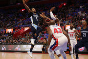 Andrew Harrison #5 of the Memphis Grizzlies drives the ball to the basket as Andre Drummond #0 of the Detroit Pistons defends during the second quarter of the game at Little Caesars Arena on February 1, 2018 in Detroit, Michigan. NOTE TO USER: User expressly acknowledges and agrees that, by downloading and or using this photograph, User is consenting to the terms and conditions of the Getty Images License Agreement