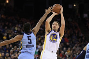 Klay Thompson #11 of the Golden State Warriors shoots over Andrew Harrison #5 of the Memphis Grizzlies at ORACLE Arena on December 20, 2017 in Oakland, California. NOTE TO USER: User expressly acknowledges and agrees that, by downloading and or using this photograph, User is consenting to the terms and conditions of the Getty Images License Agreement.