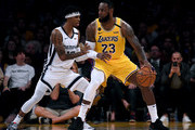 LeBron James #23 of the Los Angeles Lakers posts up Ja Morant #12 of the Memphis Grizzlies during the third quarter at Staples Center on February 21, 2020 in Los Angeles, California.  NOTE TO USER: User expressly acknowledges and agrees that, by downloading and or using this photograph, User is consenting to the terms and conditions of the Getty Images License Agreement.