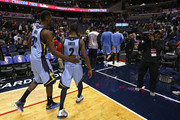 Russ Smith #2 of the Memphis Grizzlies and teammate Jeff Green #32 walk off the court after losing to the Washington Wizards at Verizon Center on March 12, 2015 in Washington, DC. NOTE TO USER: User expressly acknowledges and agrees that, by downloading and or using this photograph, User is consenting to the terms and conditions of the Getty Images License Agreement.