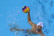 Maurizio Felugo (Top) of Italy is faced by Eric Marsal Marti of Spain during the Men's Water Polo quarterfinal match between Italy and Spain during Day Eleven of the 14th FINA World Championships at the Oriental Sports Center on July 26, 2011 in Shanghai, China.