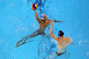 Keigo Okawa of Japan is faced by Scott Robinson of Canada during the Men's Water Polo first preliminary round match between Japan and Canada during Day Three of the 14th FINA World Championships at the Oriental Sports Center on July 18, 2011 in Shanghai, China.