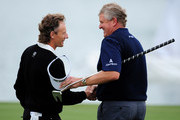 Bernhard Langer (L) of Germany shakes hands with Colin Montgomerie of Scotland during the first round of The Mercedes-Benz Championship at The Gut Larchenhof Golf Club on September 10, 2009 in Cologne, Germany.