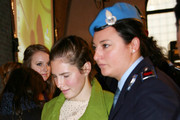 Deanna Knox (L) looks at her sister Amanda Knox (C) as she leaves the Perugia courthouse during a break in the closing arguments for the Meredith Kercher murder trial on December 3, 2009 in Perugia, Italy. Amanda Knox and her former Italian boyfriend Raffaele Sollecito have been charged with the murder of British student Meredith Kercher on November 1, 2007 in Italy. Jury deliberation will begin on December 4, with a verdict expected either that evening or the following day.