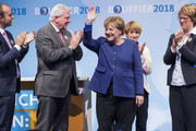 German Chancellor and leader of the German Christian Democrats (CDU) Angela Merkel (C), lead local CDU candidate Volker Bouffier (2-L) and his wife Ursula Bouffier (2-R) attend a CDU Hesse state election rally on October 23, 2018 in Dieburg, Germany. Hesse is scheduled to hold state elections on October 28 and so far polls indicate the German Christian Democrats (CDU), the party of Chancellor Angela Merkel, and the German Social Democrats (SPD) will fair poorly, while both the German Greens Party and the right-wing Alternative for Germany (AfD) can expect strong gains.