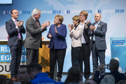 German Chancellor and leader of the German Christian Democrats (CDU) Angela Merkel (C), lead local CDU candidate Volker Bouffier (2-L) and his wife Ursula Bouffier (3-R) attend a CDU Hesse state election rally on October 23, 2018 in Dieburg, Germany. Hesse is scheduled to hold state elections on October 28 and so far polls indicate the German Christian Democrats (CDU), the party of Chancellor Angela Merkel, and the German Social Democrats (SPD) will fair poorly, while both the German Greens Party and the right-wing Alternative for Germany (AfD) can expect strong gains.