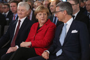 """(L to R) ThyssenKrupp AG Chairman Heinrich Hiesinger, German Chancellor Angela Merkel and German Federation of Industry (BDI) President Ulrich Grillo attend the """"Day of German Industry"""" annual gathering on November 3, 2015 in Berlin, Germany. Hosted by the BDI, the annual gathering brings together industrial leaders from across Germany as well as political leaders."""