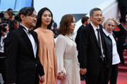 """(L-R) Jeong Jinyoung, Kim Minheet, Isabelle Hupert, director Hong SangSoo and guest of  'Claire's Camera (Keul-Le-Eo-Ui-Ka-Me-La)' walk the red carpet ahead of the """"The Meyerowitz Stories"""" screening during the 70th annual Cannes Film Festival at Palais des Festivals on May 21, 2017 in Cannes, France."""
