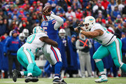 Tyrod Taylor and Ndamukong Suh Photos Photo