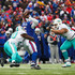 Charles Harris Photos - Charles Harris #90 of the Miami Dolphins and teammate Ndamukong Suh #93 attempt to tackle Tyrod Taylor #5 of the Buffalo Bills during the first quarter on December 17, 2017 at New Era Field in Orchard Park, New York. - Miami Dolphins vBuffalo Bills