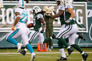 Chris Ivory #33 of the New York Jets scores a touchdown against the Miami Dolphins during their game at MetLife Stadium on November 29, 2015 in East Rutherford, New Jersey.