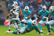 Jeremy Kerley #11 of the New York Jets beats the tackle of Neville Hewitt #46 of the Miami Dolphins  during the game at Wembley Stadium on October 4, 2015 in London, England.