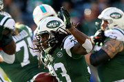 Chris Ivory #33 of the New York Jets carries the ball in the first quarter against the Miami Dolphins on November 29, 2015 at MetLife Stadium in East Rutherford, New Jersey.