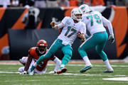Ryan Tannehill #17 of the Miami Dolphins slips away from an attempted tackle by Preston Brown #52 of the Cincinnati Bengals during the fourth quarter at Paul Brown Stadium on October 7, 2018 in Cincinnati, Ohio. Cincinnati defeated Miami 27-17.