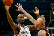 Kevin Garnett #2 of the Brooklyn Nets passes the ball as Chris Andersen #11 of the Miami Heat defends in Game Three of the Eastern Conference Semifinals during the 2014 NBA Playoffs at the Barclays Center on May 10, 2014 in the Brooklyn borough of New York City. NOTE TO USER: User expressly acknowledges and agrees that, by downloading and/or using this photograph, user is consenting to the terms and conditions of the Getty Images License Agreement.