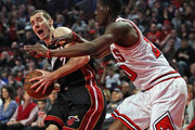 Goran Dragic #7 of the Miami Heat is fouled by Tony Snell #20 of the Chicago Bulls at the United Center on March 11, 2016 in Chicago, Illinois. NOTE TO USER: User expressly acknowledges and agrees that, by downloading and or using the photograph, User is consenting to the terms and conditions of the Getty Images License Agreement.