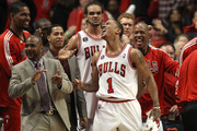 (L-R) Kurt Thomas #40, John Lucas III, Joakim Noah #13, Derrick Rose #1 and Keith Bogans #6 of the Chicago Bulls celebrate late in the fourth quarter against the Miami Heat in Game One of the Eastern Conference Finals during the 2011 NBA Playoffs on May 15, 2011 at the United Center in Chicago, Illinois. The Bulls won 103-82. NOTE TO USER: User expressly acknowledges and agrees that, by downloading and or using this photograph, User is consenting to the terms and conditions of the Getty Images License Agreement