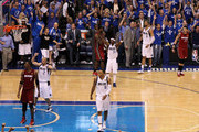Jaosn Kidd #2, Shawn Marion #0, Jason Terry #31 and Tyson Chandler #6 of the Dallas Mavericks celebrate their 86-83 win as Chris Bosh #1, LeBron James #6 and Mike Miller #13 of the Miami Heat look on dejected after Miller missed the final field goal attempt of the game in Game Four of the 2011 NBA Finals at American Airlines Center on June 7, 2011 in Dallas, Texas. NOTE TO USER: User expressly acknowledges and agrees that, by downloading and/or using this Photograph, user is consenting to the terms and conditions of the Getty Images License Agreement
