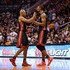 Ray Allen Photos - Chris Bosh #1 of the Miami Heat is congratulated by Ray Allen #34 after Bosh hit a three point shot against the Phoenix Suns during the second half of the NBA game at US Airways Center on February 11, 2014 in Phoenix, Arizona.  NOTE TO USER: User expressly acknowledges and agrees that, by downloading and or using this photograph, User is consenting to the terms and conditions of the Getty Images License Agreement. - Miami Heat v Phoenix Suns