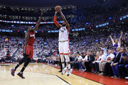 Patrick Patterson #54 of the Toronto Raptors shoots for a 3-pointer as Luol Deng #9 of the Miami Heat defends in Game Seven of the Eastern Conference Quarterfinals during the 2016 NBA Playoffs at the Air Canada Centre on May 15, 2016 in Toronto, Ontario, Canada.  NOTE TO USER: User expressly acknowledges and agrees that, by downloading and or using this photograph, User is consenting to the terms and conditions of the Getty Images License Agreement.