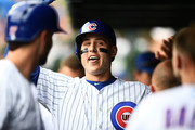 Anthony Rizzo #44 of the Chicago Cubs is congratulated by teammates following a three run home run against the Miami Marlins during the third inning of a game at Wrigley Field on May 9, 2018 in Chicago, Illinois.