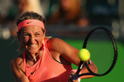 Victoria Azarenka of Belarus plays a backhand against Agnieszka Radwanska of Poland in their fourth round match during the Miami Open Presented by Itau at Crandon Park Tennis Center on March 26, 2018 in Key Biscayne, Florida.