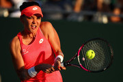Agnieszka Radwanska of Poland plays a backhand against Victoria Azarenka of Belarus in their fourth round match during the Miami Open Presented by Itau at Crandon Park Tennis Center on March 26, 2018 in Key Biscayne, Florida.