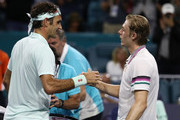 Roger Federer of Switzerland meets Denis Shapovalov of Canada after defeating him during day 12 of the Miami Open presented by Itau at Hard Rock Stadium on March 29, 2019 in Miami Gardens, Florida.