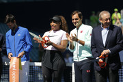 (from left) Novak Djokovic of Serbia, Serena Williams of the United States, Roger Federer of Switzerland, and Miami Dolphins owner Stephen Ross cut the ribbon during the Ribbon Cutting ceremony on Day 3 of the Miami Open Presented by Itau on March 20, 2019 in Miami Gardens, Florida.