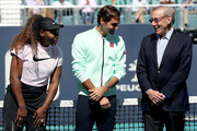 Serena Williams and Roger Federer of Switzerland speak to Stephen Ross at the ribbon cutting ceremony held on center court during the Miami Open Presented by Itau at Hard Rock Stadium March 20, 2019 in Miami Gardens, Florida.