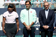 Serena Williams, Roger Federer of Switzerland and Stephen Ross attend the ribbon cutting ceremony held on center court during the Miami Open Presented by Itau at Hard Rock Stadium March 20, 2019 in Miami Gardens, Florida.