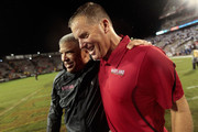 Head coach Randy Edsall (R) is congratulated by athletic director Kevin Anderson (L) after the Terrapins defeated the Miami Hurricanes 32-24 at Byrd Stadium on September 5, 2011 in College Park, Maryland.
