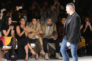 Christina Milian, Karrueche Tran, Chris Brown, and designer Michael Costello (R) attend the Michael Costello fashion show during Mercedes-Benz Fashion Week Fall 2015  at The Salon at Lincoln Center on February 17, 2015 in New York City.