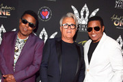 (L-R) Tito Jackson, Giuseppe Zanotti and Jackie Jackson attend the Michael Jackson diamond birthday celebration at ?Michael Jackson ONE by Cirque du Soleil? at the Mandalay Bay Resort and Casino on August 29, 2018 in Las Vegas, Nevada.
