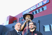 Michael Long and his son Jake Long pose infront of a statue of himself at The Hangar at the Essendon Bombers Football Club on July 17, 2018 in Melbourne, Australia. Former player Michael Long is being recognised for this contribution to honouring Australia's First Nations Peoples.