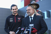 Michael Long supported by his son Jake Long speaks to the media infront of a statue of himself at The Hangar at the Essendon Bombers Football Club on July 17, 2018 in Melbourne, Australia. Former player Michael Long is being recognised for this contribution to honouring Australia's First Nations Peoples.