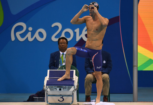 Swimming - Olympics: Day 3 [barechested,muscle,competition,sports,michael phelps,olympics,united states,brazil,rio de janeiro,olympic aquatics stadium,mens 200m butterfly,semifinal,rio 2016 olympic games]
