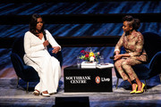 Former U.S. First Lady Michelle Obama speaks with Nigerian author Chimamanda Ngozi Adichie at The Royal Festival Hall on December 03, 2018 in London, England. The former First Lady's memoir titled 'Becoming' has become the best selling book in the US for 2018 according to figures released by her publisher Penguin Random House.