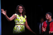 Former U.S. first lady Michelle Obama waves after discussing her forthcoming memoir with Dr. Carla Hayden the 14th Librarian of Congress titled, 'Becoming', during the 2018 American Library Association Annual Conference on June 22, 2018 in New Orleans, Louisiana.
