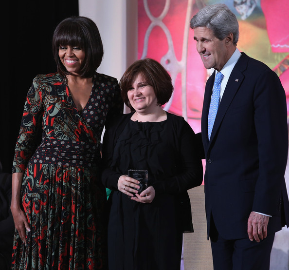 """Michelle Obama Investigative journalist Elena Milashina (C) of Russia poses for photographs with U.S. Secretary of State John Kerry (R) and U.S. first lady Michelle Obama after receiving the International Women of Courage award at the State Department March 8, 2013 in Washington, DC. In celebration of the 102nd International Women's Day, the State Department honored nine women from around the world with the International Women of Courage Award, including the 23-year-old Indian woman known only as """"Nirbhaya,"""" who died from injuries she received after being gang raped by six men last December in Delhi."""