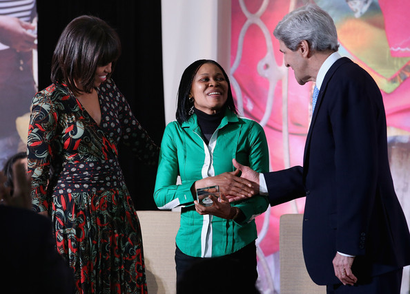 """Michelle Obama Women's rights advocate Dr. Josephine Obiajulu Odumakin (C) of Nigeria is congratulated by U.S. Secretary of State John Kerry (R) and U.S. first lady Michelle Obama after Odumakin received the International Women of Courage award at the State Department March 8, 2013 in Washington, DC. In celebration of the 102nd International Women's Day, the State Department honored nine women from around the world with the International Women of Courage Award, including the 23-year-old Indian woman known only as """"Nirbhaya,"""" who died from injuries she received after being gang raped by six men last December in Delhi."""