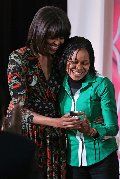 """Michelle Obama U.S. first lady Michelle Obama (L) embraces women's rights advocate Dr. Josephine Obiajulu Odumakin of Nigeria after she received her International Women of Courage award at the State Department March 8, 2013 in Washington, DC. In celebration of the 102nd International Women's Day, the State Department honored nine women from around the world with the International Women of Courage Award, including the 23-year-old Indian woman known only as """"Nirbhaya,"""" who died from injuries she received after being gang raped by six men last December in Delhi."""