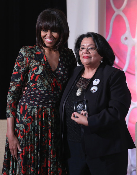 """Michelle Obama Honduras Truth and Reconciliation Commission member Julieta Castellanos (R) poses for photographs with U.S. first lady Michelle Obama after receiving the International Women of Courage award at the State Department March 8, 2013 in Washington, DC. In celebration of the 102nd International Women's Day, the State Department honored nine women from around the world with the International Women of Courage Award, including the 23-year-old Indian woman known only as """"Nirbhaya,"""" who died from injuries she received after being gang raped by six men last December in Delhi."""