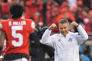 Head Coach Urban Meyer of the Ohio State Buckeyes salutes Braxton Miller  #5 of the Ohio State Buckeyes as Miller is introduced for senior day before the game against the Michigan State Spartans at Ohio Stadium on November 21, 2015 in Columbus, Ohio.